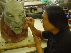 Steve Wang sculptus the head and neck of a Lycan.