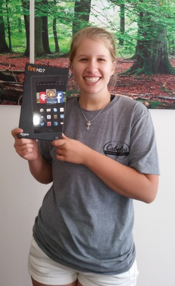 Photo of winner Stacey Marks holding her Kindle Fire