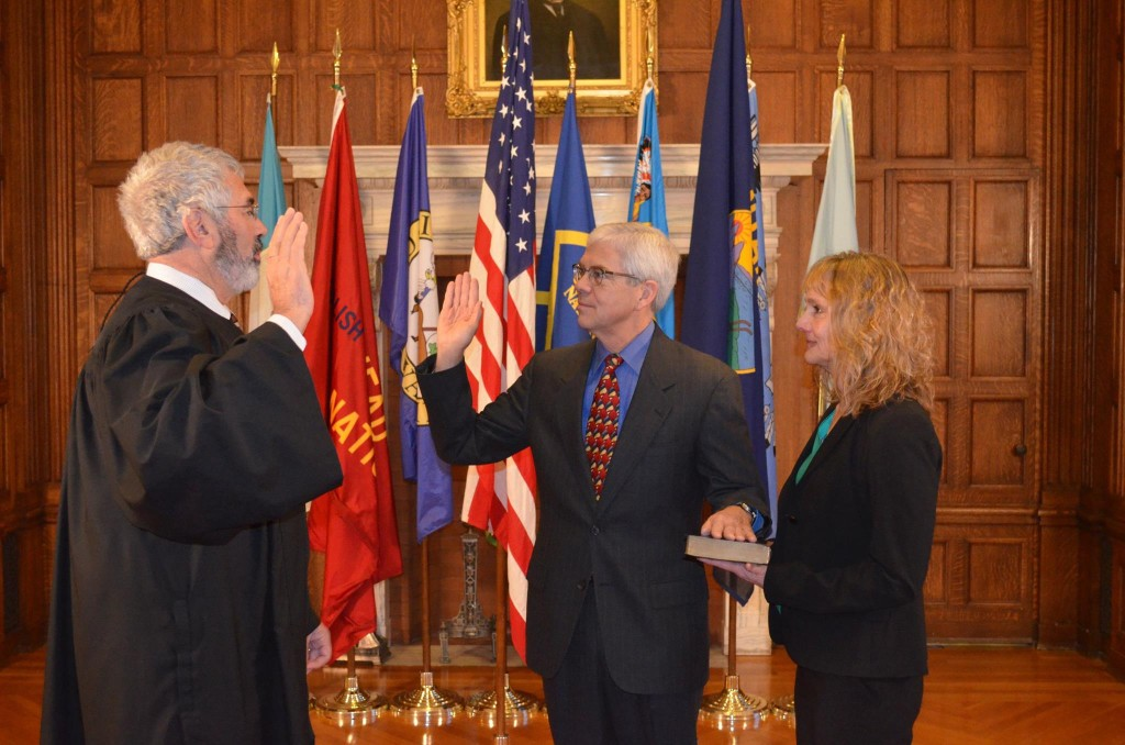 Chief Justice Mike McGrath, right, swears in Mike Cooney as Montana's 32nd lieutenant governor with Cooney's wife, Helena District Judge DeeAnn Cooney, at his side. - photo courtesy Gov. Steve Bullock's official Facebook page.