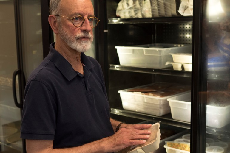 Livingston Food Resource Center Executive Director Michael McCormick stands in the kitchen of the food resource center and discusses how state cuts to programs that serve the needy have a disproportionate impact in rural communities.