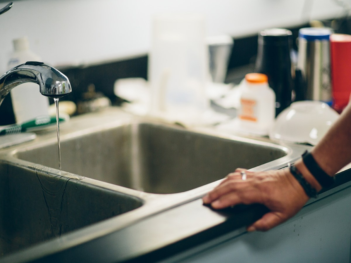 A water faucet runs with a small trickle of water at a water treatment plant on the Fort Peck Indian Reservation.