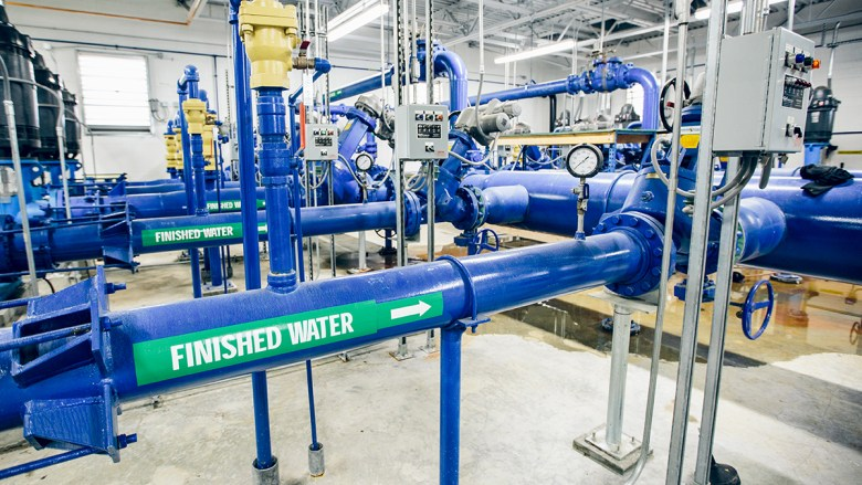 A tangle of blue water pipes at the Fort Peck water treatment plant move clean, treated water.