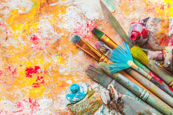 Artists Paint and Brushes on Canvas
