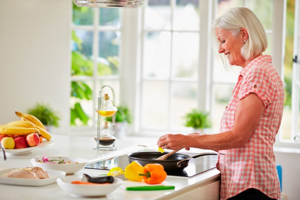 Senior woman prepairing fresh, real food for better health.