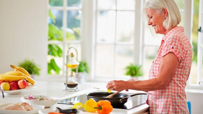 Senior woman prepairing fresh, real food for better health.