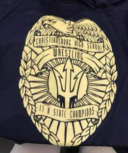 Photos courtesy of Blue Demon Wrestling Club State champion Marshall Keller has designed a t-shirt that honors the 17th straight title.