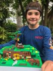 Wyatt Semones, 11, shows off his winning LEGO home in the 9-11 age group.