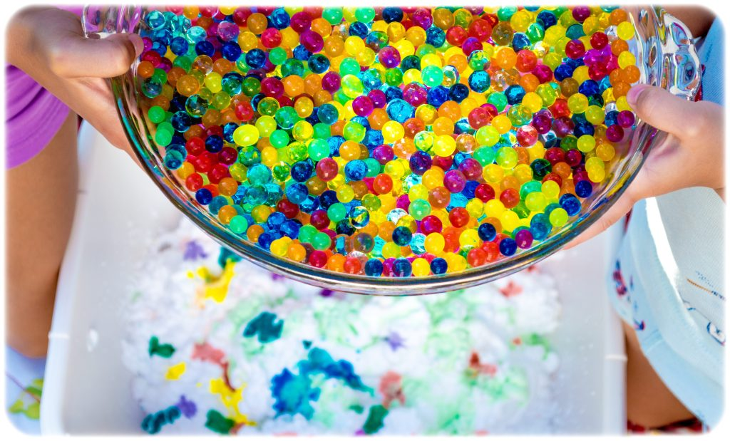 pouring-colorful-water-beads-in-shaving-foam