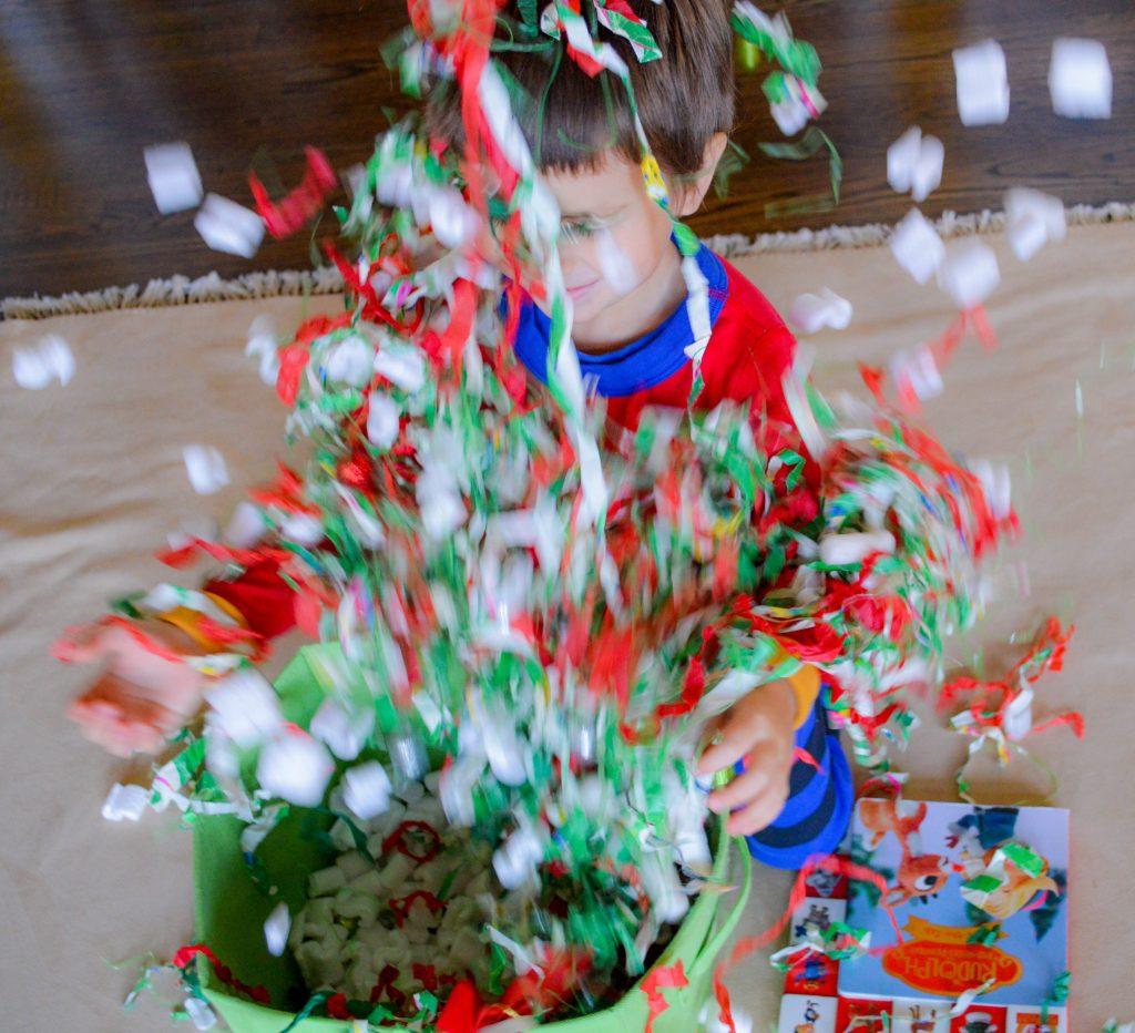 Shredded Paper Rudolph the Red-Nosed Reindeer Christmas Sensory Bin