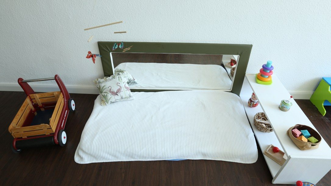 montessori newborn movement area with mirror and mobiles