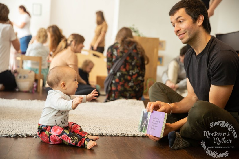 father reading to daughter a montessori book for babies about baby bears in a parent and child class