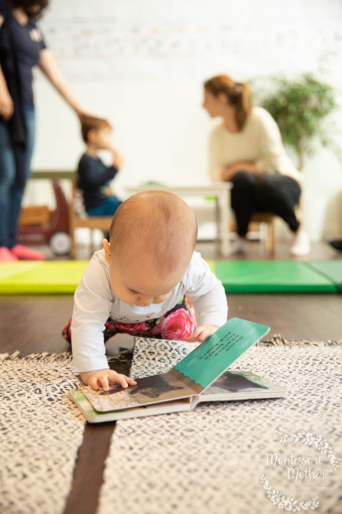baby reading a book about baby bears montessori freedom of movement concentration