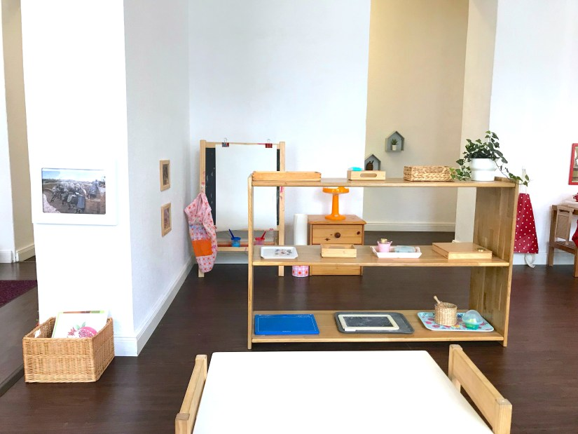 montessori diy toddler art shelf with low table painting hanging work and ikea hack easel create activities on trays for young children in berlin