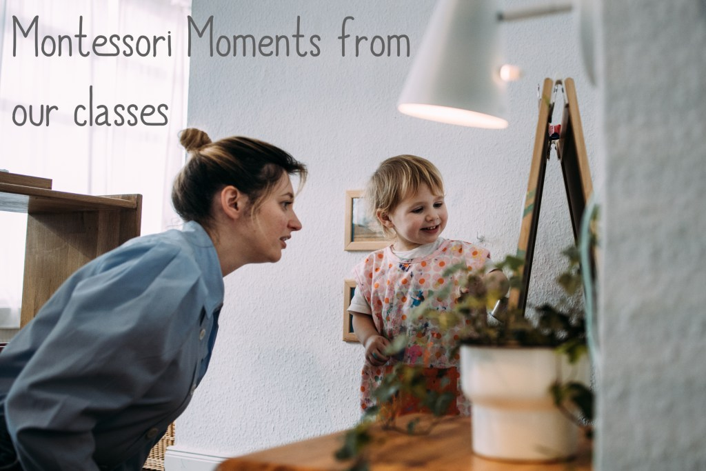 Have a look inside our montessori baby and toddler classrooms through Montessori Moments, a series of videos, episodes featuring montessori materials used in the class. pictured is a toddler and her mother painting at the montessori ikea hack easel which is shortened to the child's height in our montessori art area