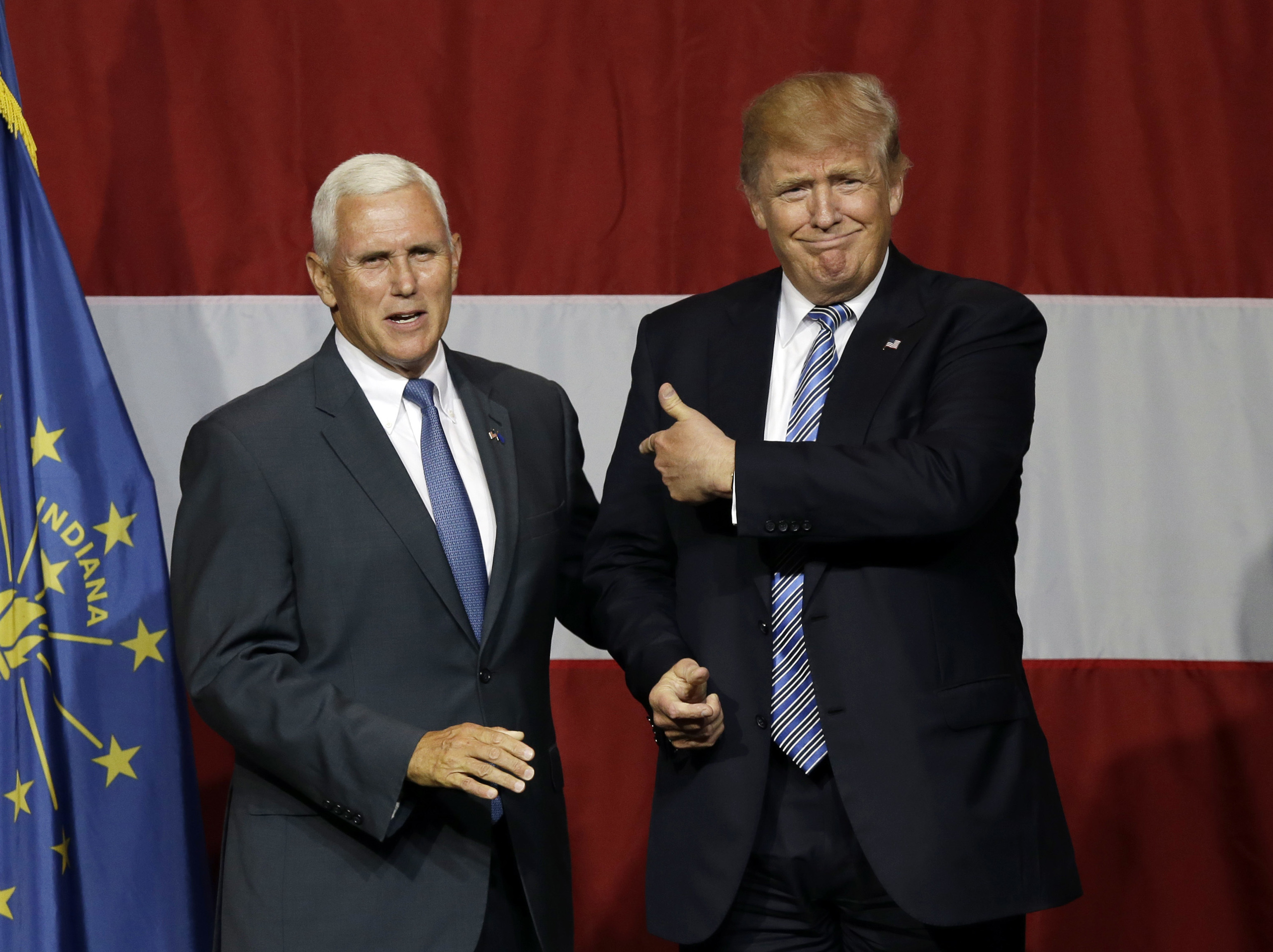 Indiana Gov. Mike Pence joins Republican presidential candidate Donald Trump at a rally in Westfield, Ind., Tuesday, July 12, 2016. (AP Photo/Michael Conroy)