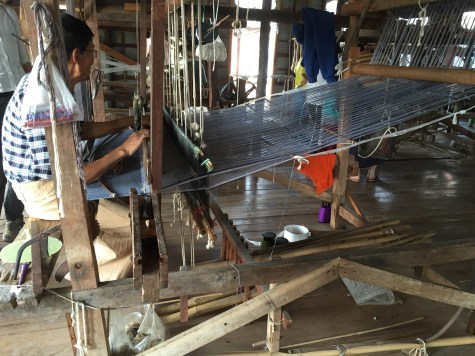 Man weaving complex fabric