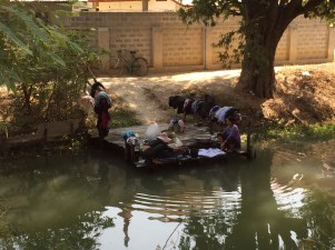 Women washing their clothes in the stream
