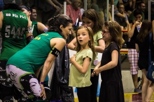 A La Racaille player greeting fans. Photo Shaun Ventura