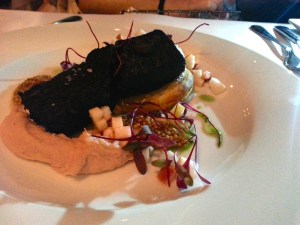 Le Grain de Sel's Black Pudding with Apple Galette and Mustard Caviar. Photo by Annie Shreeve