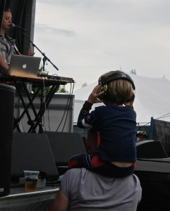 Boy with his dad at Wolfe Island Music Festival 2015. Photo Stephanie Weiner.