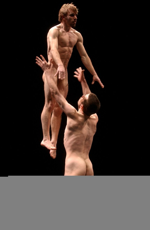 Dave St. Pierre, being hoisted in the air by David Kilburn as they rehearse for Amour, Acide et Noix, March 11, 2004 John Morstad/Globe and Mail