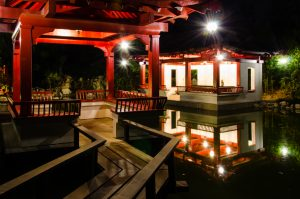 Gazebo seats and pond at night
