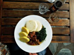 Roasted pork, bread and potato dumplings with spinach