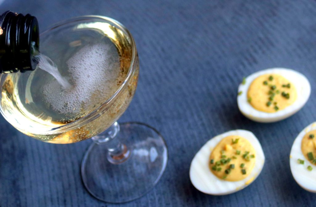 Champagne and eggs are a most elegant pairing for spring brunches, Easter or Ostara festivities. This deviled eggs recipe adds the acidity and brightness of sparkling white wine to the rich, creamy decadence of eggs.