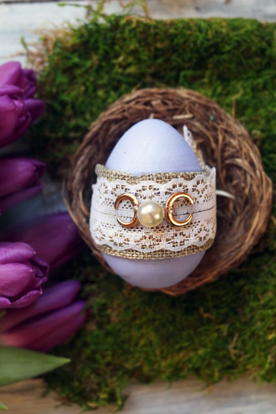 Ostara wishing egg spell with triple moon motif.