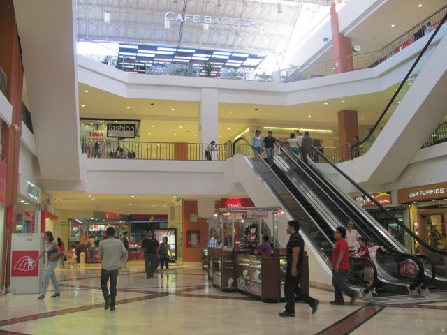 Interior view of a mall with glossy modern architecture.