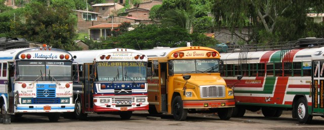 A row of colorful buses waiting at the station in Rivas.