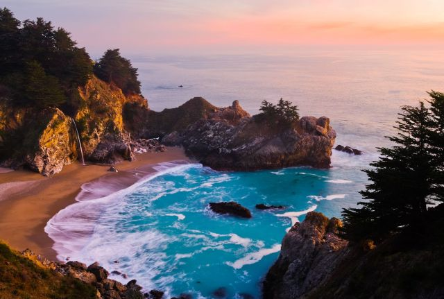 The thin stream of McWay Falls takes backseat to the dramatic rocky cove studded with pines.