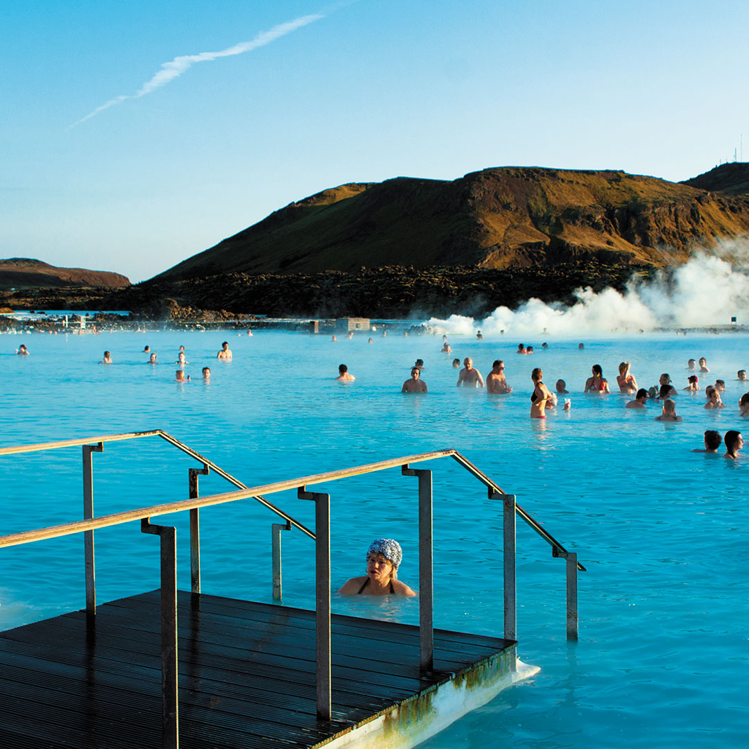people in a steaming mineral pool in Iceland.