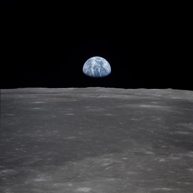 Apollo 11 Mission Image - View of Moon Limb, with Earth on the Horizon -  Moon: NASA Science