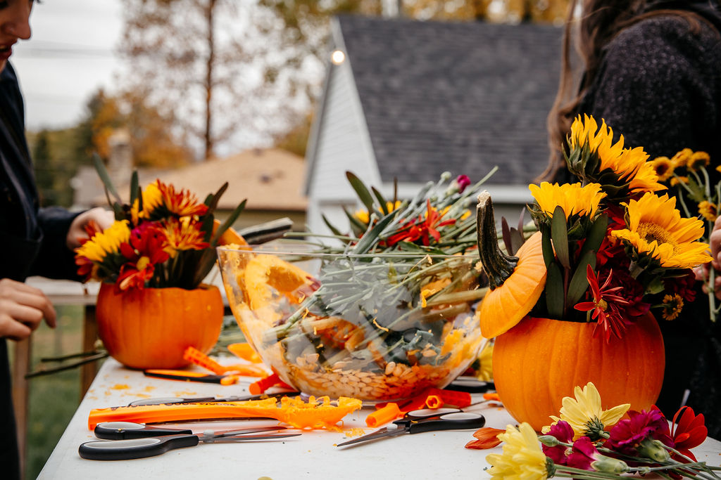 A table full of the throw away pieces for the pumpkin arrangements