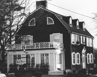 The Amityville house on 112 Ocean Avenue from 1973. One of the Warren's more famous cases they worked on