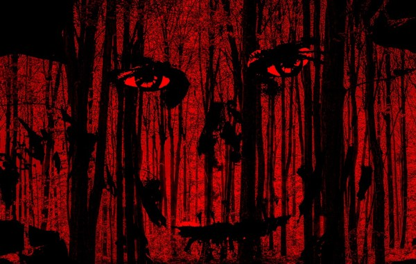 creepy red horror face in the dark forest