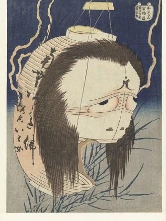 The ghost of Oiwa manifesting herself as a lantern obake. From the series One Hundred Tales (Hyaku monogatari). From the classic ghost story Yotsuya kaidan. Print by Katsushika Hokusai. 1830