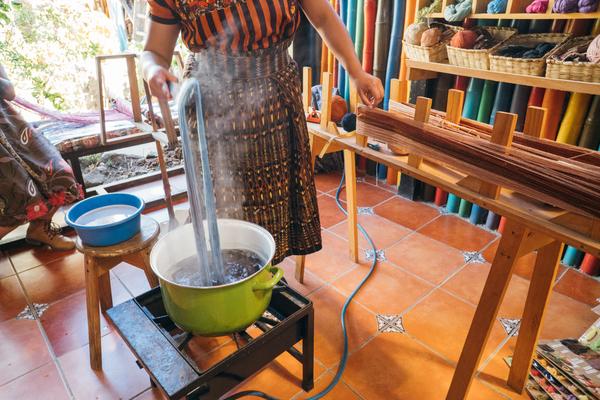 Guatemalan, Casa Flor Ixcaco, weaving artisan dying yarn