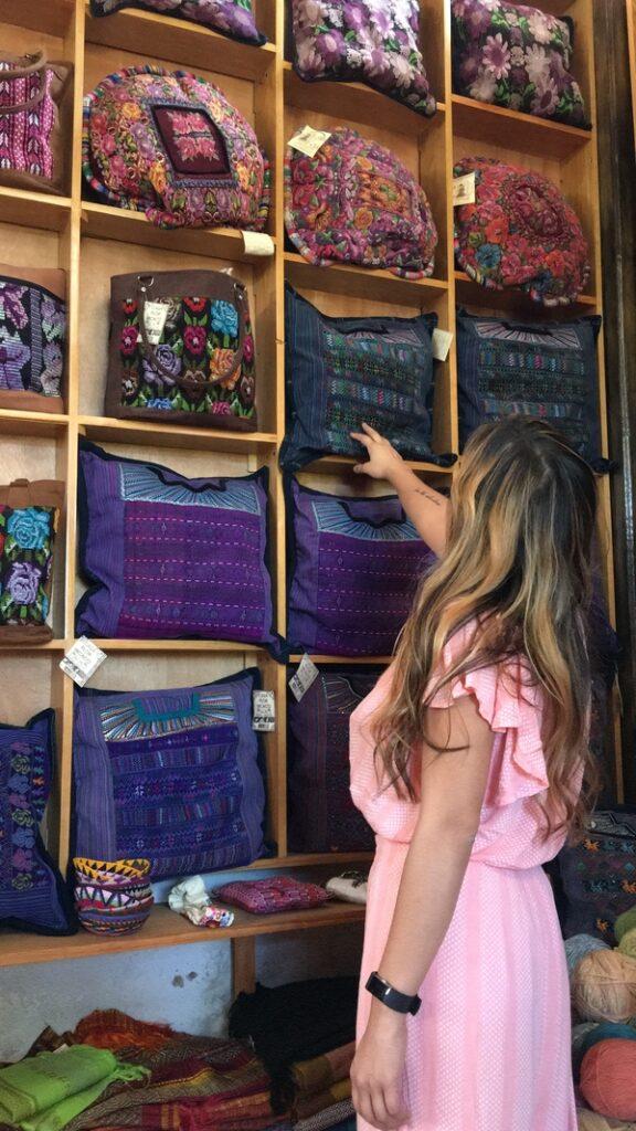 Kristina looking at Guatemalan Pillows from Casa Flor Ixcaco