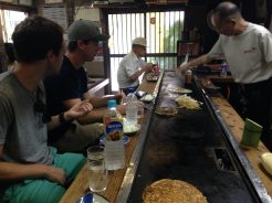 Jon showing Seth his favorite food in Japan: okonomiyaki