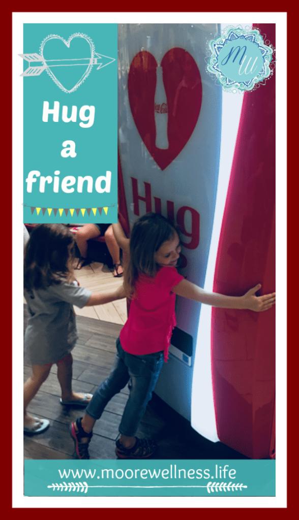 Hug a friend or a coke