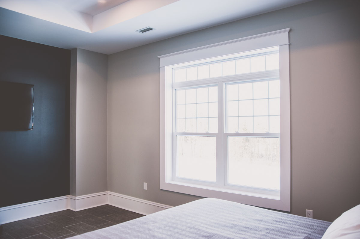 Custom home in Summerfield featuring bedroom with large windows