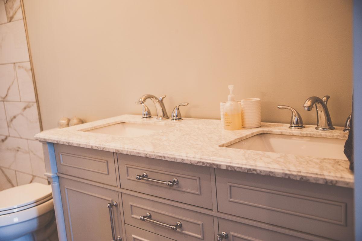 Double vanity sink in custom home built in Summerfield