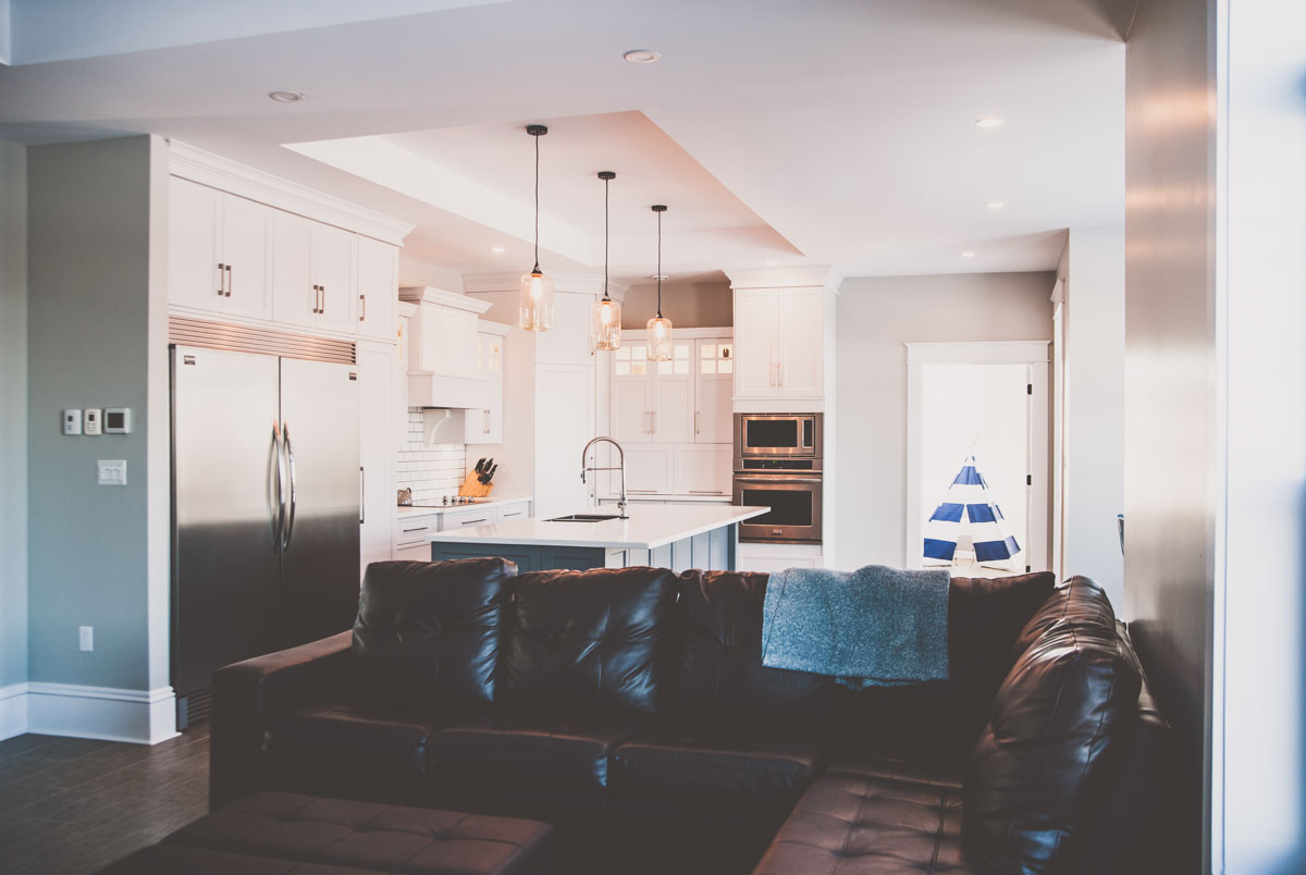 Custom home featuring kitchen and living room in Summerfield