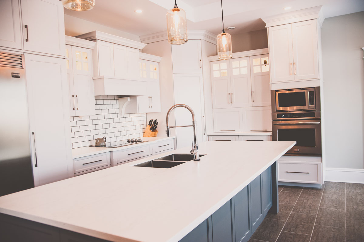 Custom home in Summerfield featuring large kitchen with island
