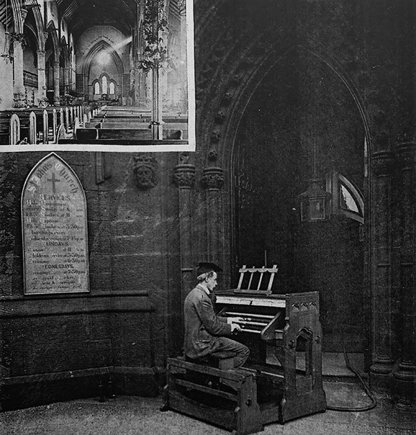 Robert Hope-Jones demonstrating  his new electric-action pipe organ;  he is playing outside the church,  but all the pipes are sounding  within the building