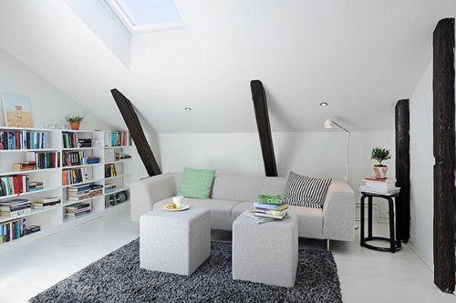 fotografia decoracio atico usado como sala de esatr sofa mesitas blancas