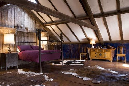 fotografia decoracion atico usado como dormitorio aspecto rustico