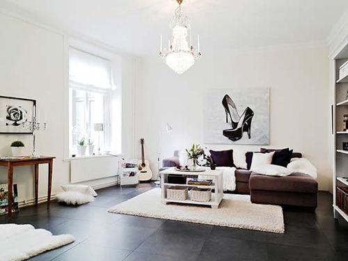 Salón blanco y negro de diseño escandinavo.
